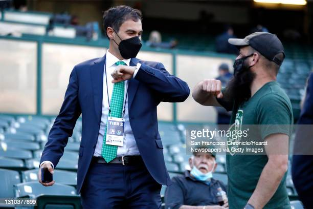 Oakland Athletics' president Dave Kaval elbow bumps a fan before A's play Houston Astros in season opener at Oakland Coliseum in Oakland, Calif., on...
