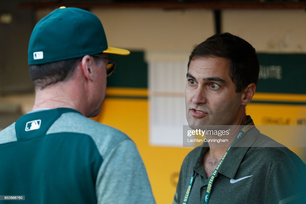 Oakland Athletics President David Kaval (right) speaks to Manager Bob Melvin #6 in the dugout before the game against the Texas Rangers at Oakland Alameda Coliseum on September 23, 2017 in Oakland, California.