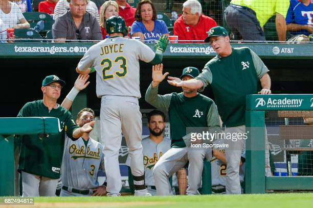 Oakland Athletics Right field Matt Joyce is congratulated after his home run by Manager Bob Melvin during the MLB game between the Oakland Athletics...