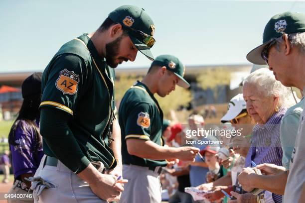 Oakland Athletics right fielder Matt Joyce signs autographs before the spring training baseball game between the Oakland Athletics and the Arizona...
