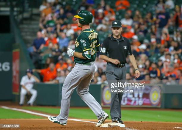 Oakland Athletics right fielder Stephen Piscotty gets a single at the top of the fifth inning during the baseball game between the Oakland Athletics...