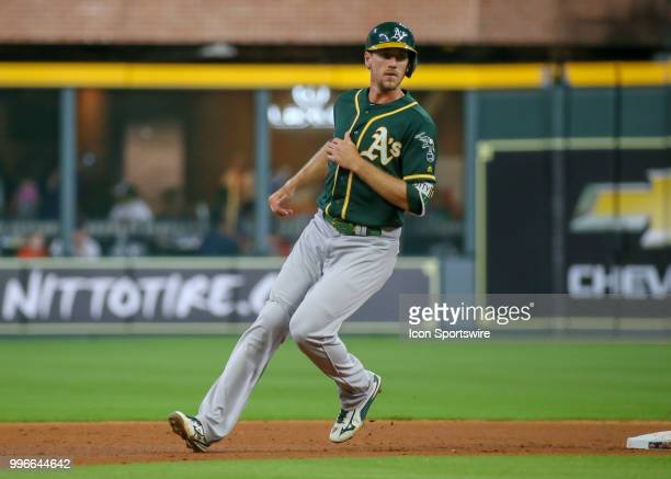 Oakland Athletics right fielder Stephen Piscotty steals second base due to a catcher's error in the top of the fifth inning during the baseball game...