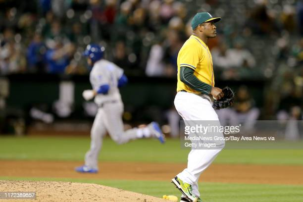 Oakland Athletics' Santiago Casilla reacts as Kansas City Royals' Drew Butera circles the bases after hitting his tworun home run in the eighth...