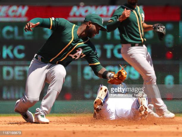 Oakland Athletics second baseman Jurickson Profar is late on the tag as Texas Rangers' Delino DeShields steals second in the first inning on Sunday...