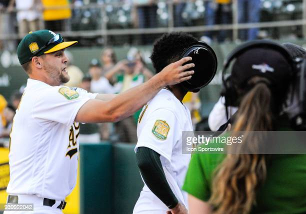 Oakland Athletics shortstop Chad Pinder pies Oakland Athletics shortstop Marcus Semien during an interview during opening day regular season game...