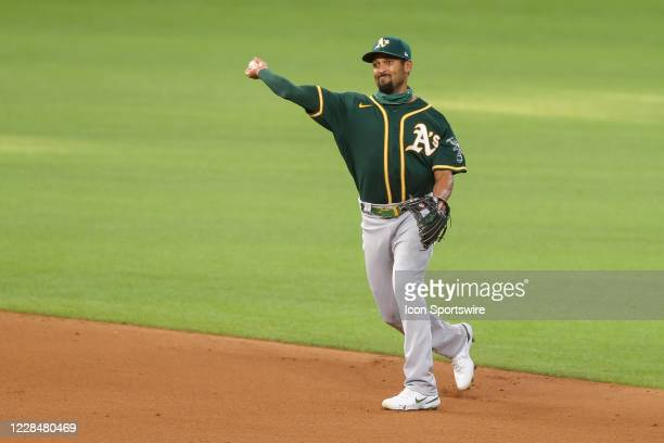 Oakland Athletics shortstop Marcus Semien throws over to first base after fielding a ground ball during the first game of a double-header between the...