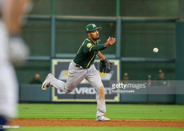 Oakland Athletics shortstop Marcus Semien throws the ball to make a play at first base during the baseball game between the Oakland Athletics and...