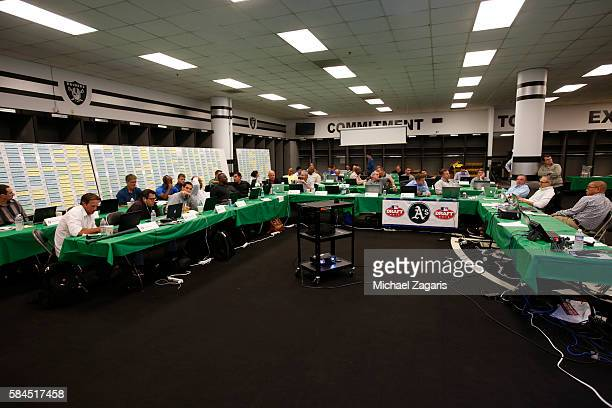 Oakland Athletics staff wait to make the team's first selection in the war room during the first day of the 2016 MLB Draft at the Oakland Coliseum on...