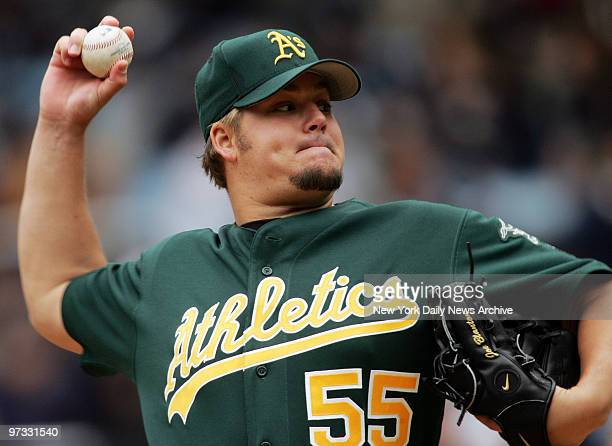 Oakland Athletics' starter Joe Blanton pitches against the New York Yankees in the first inning of game at Yankee Stadium He allowed four hits and...