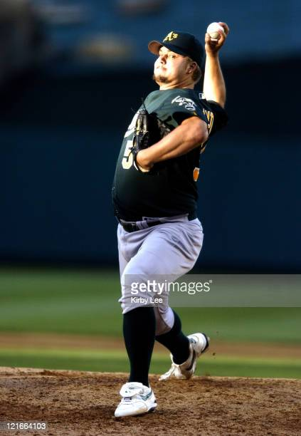 Oakland Athletics starter Joe Blanton pitches during 10 loss to the Los Angeles Angels of Anaheim at Angel Stadium in Anaheim Calif on Sunday April...