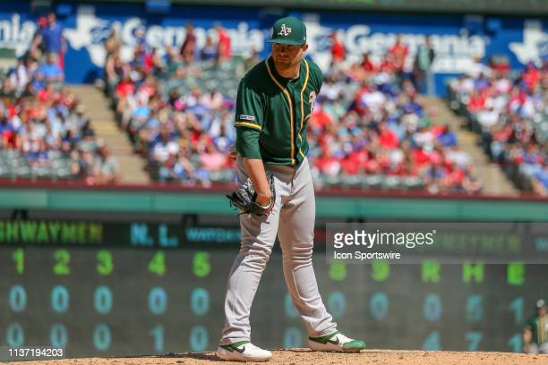 Oakland Athletics starting pitcher Brett Anderson looks on for the sign during the game between the Oakland Athletics and Texas Rangers on April 14...