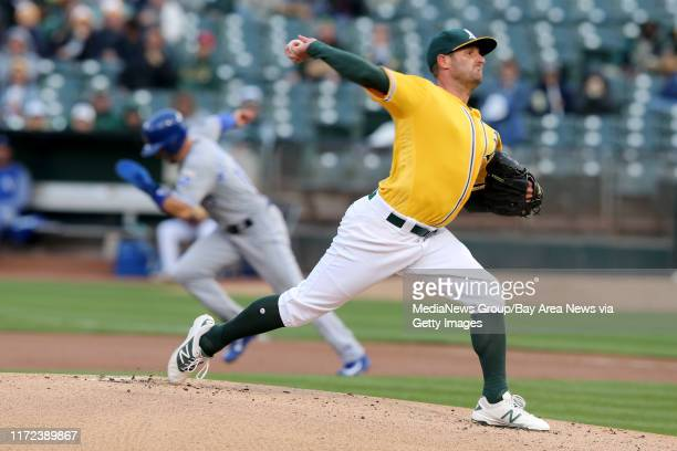 Oakland Athletics starting pitcher Chris Smith delivers against the Kansas City Royals as Whit Merrifield runs to steal second base in the first...