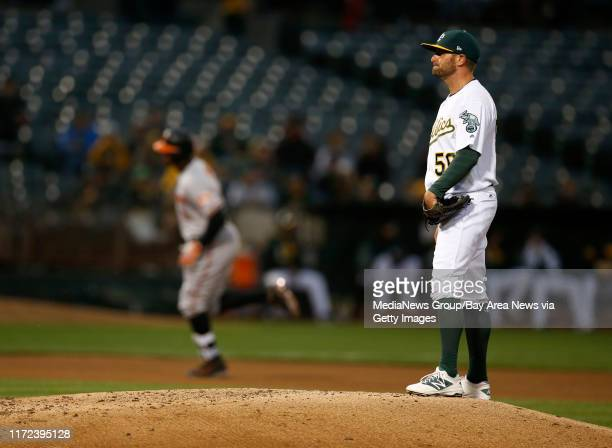 Oakland Athletics starting pitcher Chris Smith stands on the pitchers mound after giving up a solo home run against Baltimore Orioles' Adam Jones in...