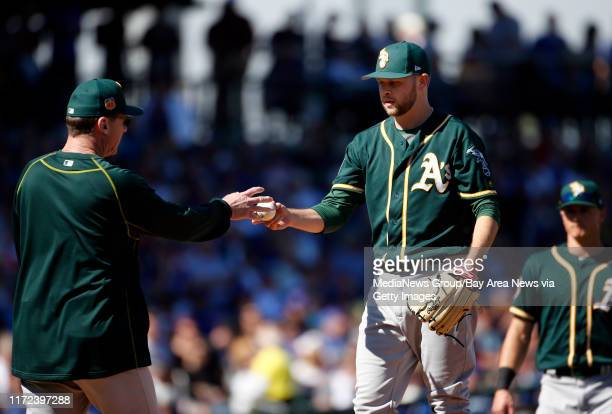 Oakland Athletics starting pitcher Jesse Hahn gives the ball to manager Bob Melvin after giving up three runs to the Chicago Cubs during the Cactus...