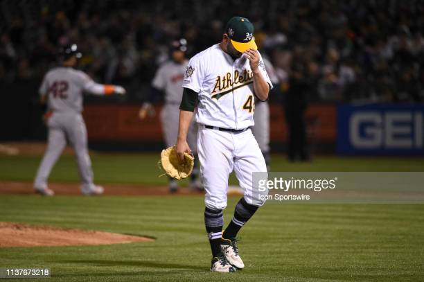 Oakland Athletics starting pitcher Marco Estrada departs the game in the top of the fourth inning during the Major League Baseball game between the...