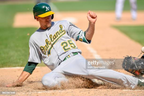 Oakland Athletics' Stephen Piscotty beats the tag at home plate to score against the Chicago White Sox on June 23 2018 at Guaranteed Rate Field in...