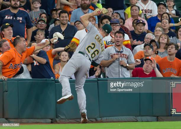 Oakland Athletics third baseman Matt Chapman attempts to make a catch in the stands during the MLB game between the Oakland Athletics and Houston...
