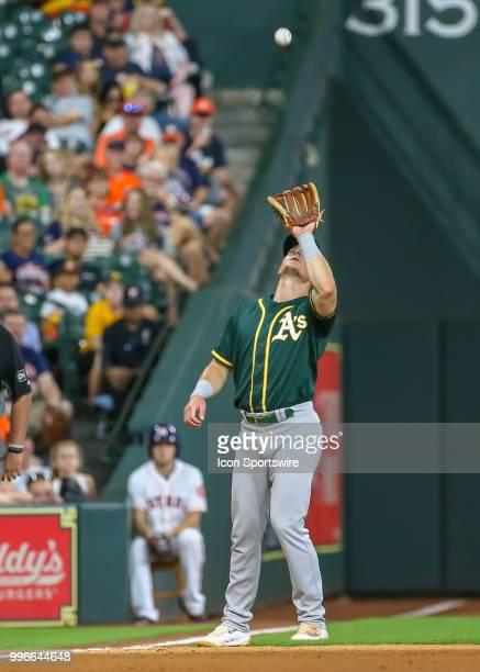 Oakland Athletics third baseman Matt Chapman catches a pop fly hit by Houston Astros designated hitter Evan Gattis in the bottom of the fifth inning...