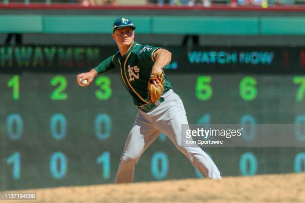 Oakland Athletics third baseman Matt Chapman makes a play on a ground ball during the game between the Oakland Athletics and Texas Rangers on April...