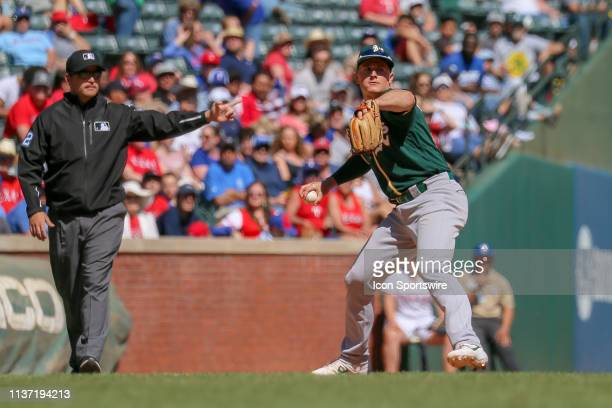 Oakland Athletics third baseman Matt Chapman steps to make a throw to first base during the game between the Oakland Athletics and Texas Rangers on...