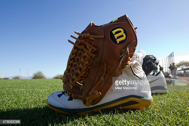 Oakland Athletics Wilson glove sits in the infield during a workout at Papago Baseball Facility on February 24 2014 in Phoenix Arizona