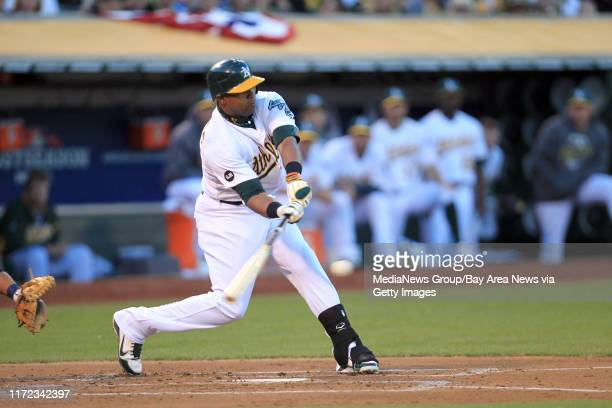 Oakland Athletics' Yoenis Cespedes connects for an RBI single against the Detroit Tigers in the first inning of Game 3 of the American League...