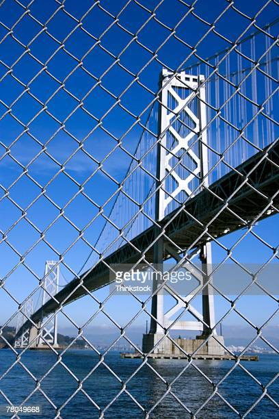 Oakland Bay Bridge through chain link fence