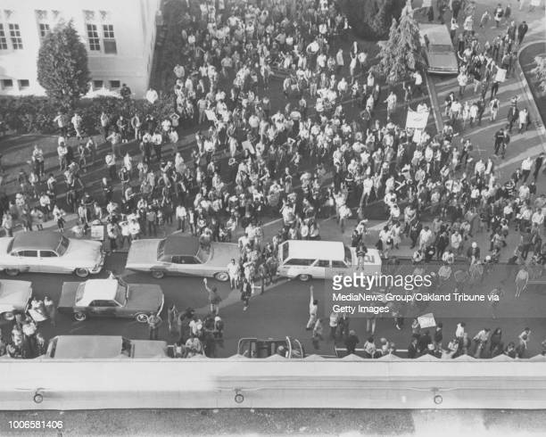 Oakland CA 8 April 1968 A crowd charges the Alameda County Courthouse during a Black Panther Party and Peace and Freedom sponsored march