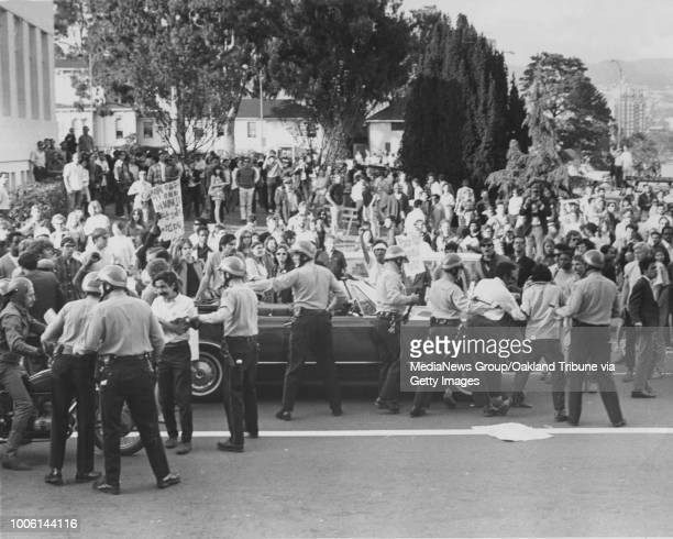 Oakland CA 8 April 1968 Sheriff's deputies move crowd of marchers off 13th Street in front of county courthouse #13#13Published 9 April 1968