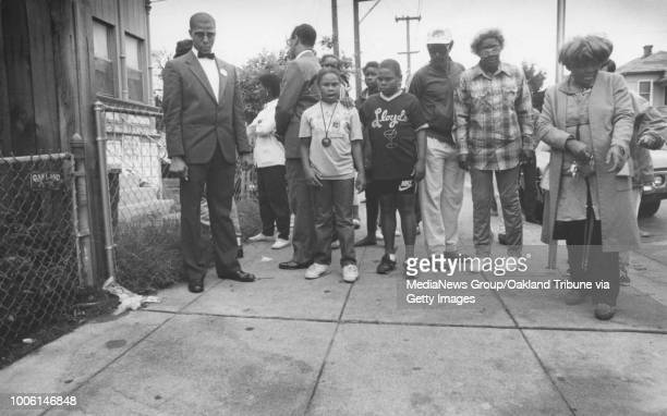 Oakland CA August 22 1989 People gather at spot where Huey Newton's body was found #13