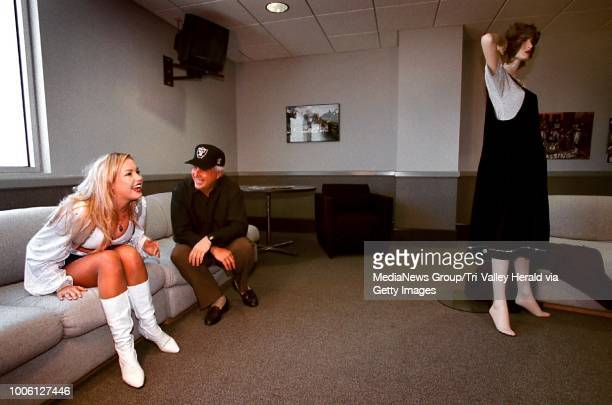 Oakland Raiders cheerleader Megan Dorsey of Livermore left shares a laugh of relief with Candid Camera's Peter Funt after finding out that she...