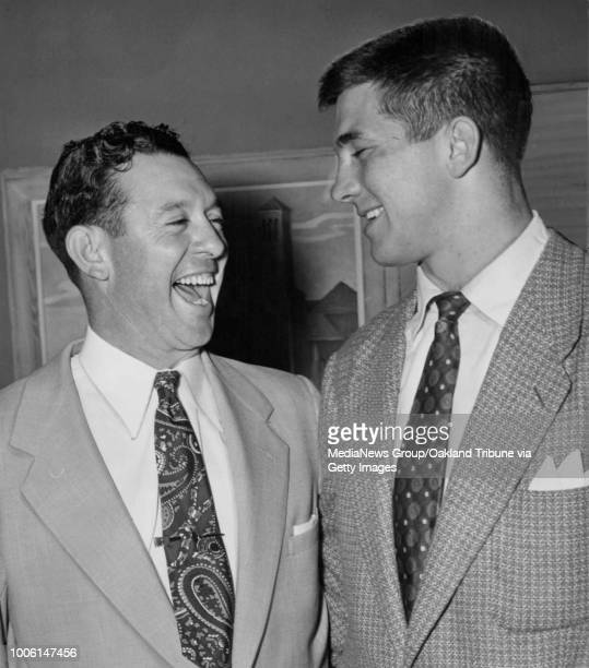 Oakland CA February 25 1952 Augie Galan left shares a laugh with Les Richter University of California at Berkeley AllAmerican football star at a...