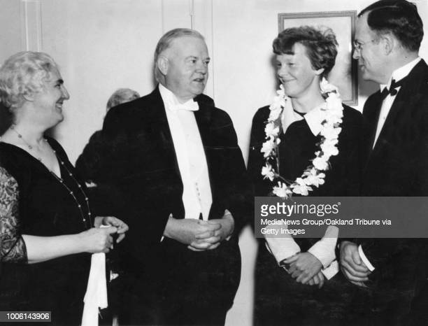 Oakland, CA January 19, 1935 - Athens Club, Oakland. Left to Right: Lou Hoover, Herbert Hoover, Amelia Earhart, and George Palmer Putnam.