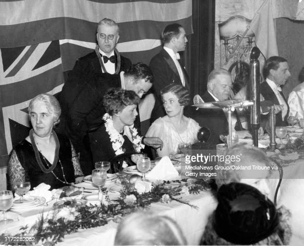 Oakland, CA January 19, 1935 - Joining Amelia Earhart, in lei, at a banquet dinner held in her honor upon returning from a solo from Hawaii at the...