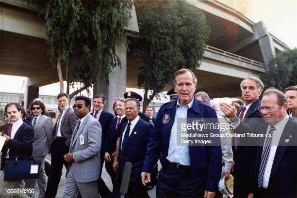 Oakland, CA October 20, 1989 - President George H. W. Bush surveys earthquake damage to the Nimitz Freeway Cypress Structure with officials.