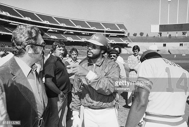 Oakland, Calif.: Oakland A's outfielder Reggie Jackson points finger at sports writer Murray Olderman on Oakland Coliseum playing field where the A's...