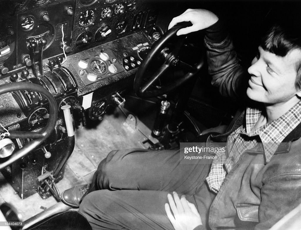 ; Oakland, California. A closeup of Amelia EARHART seated at the control of her new airplane the FLYING LABORATORY even includes a two-way radio. Miss EARHART's flight, which will cost $100.000, is expected to take between two and three weeks. She will fly with a co-pilot, Harry MANNING as far as the australian coast.