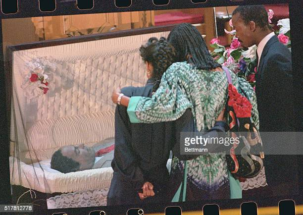 Oakland, California: Mourners comfort each other as they view the body of slain Black Panther Party co-founder Huey P. Newton before the start of...