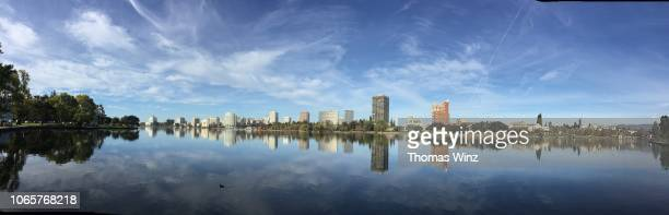 oakland cityscape with lake merritt - oakland california skyline stock pictures, royalty-free photos & images
