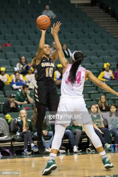 Oakland Golden Grizzlies G Taylor Jones shoots over Cleveland State Vikings F Shadae Bosley during the second quarter of the women's college...
