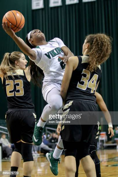Oakland Golden Grizzlies guard Chloe Guingrich is called for a blocking foul against Cleveland State Vikings forward Ashanti Abshaw during the fourth...