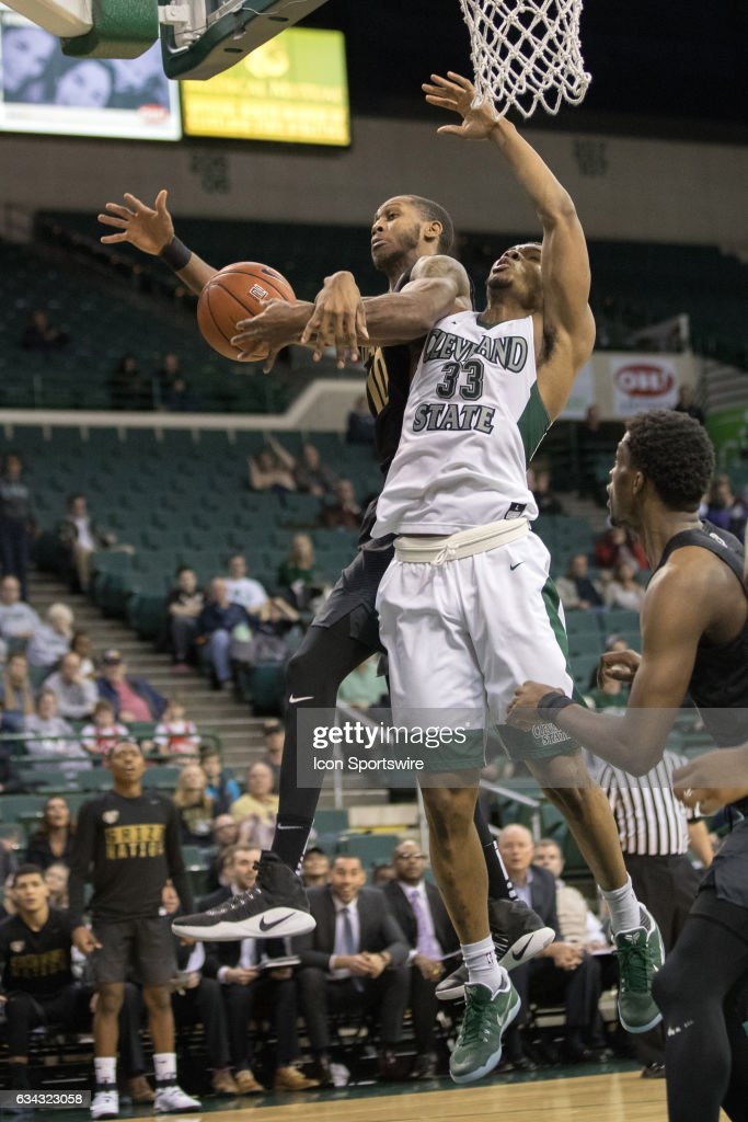 Oakland Grizzlies F Isaiah Brock (10) and Cleveland State Vikings F Demonte Flannigan (33) tangle going for a rebound during the second half of the men's college basketball game between the Oakland Grizzlies and Cleveland State Vikings on February 4, 2017, at the Wolstein Center in Cleveland, OH. Oakland defeated Cleveland State 53-51.