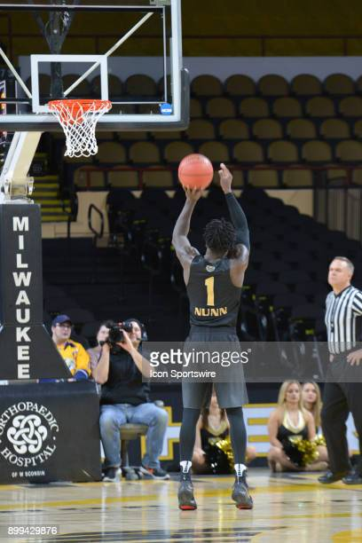 Oakland Grizzlies G Kendrick Nunn shoots a technical foul shot during the basketball game between Oakland Grizzlies and Milwaukee Panthers at...