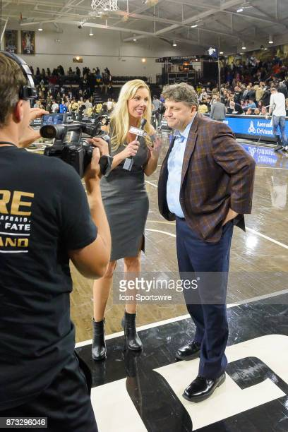 Oakland Grizzlies Head Coach Greg Kampe during a postgame interview with ESPN reporter Joanne Tuttle following the game between the Fort Wayne...