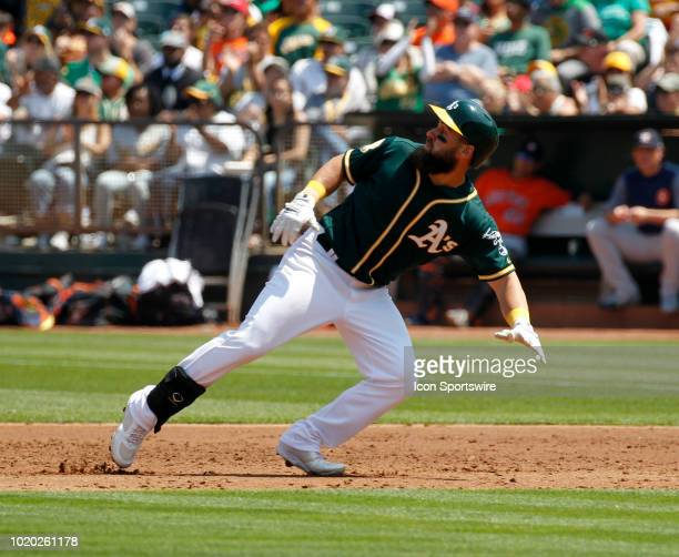 Oakland LF Nick Martini puts the breaks on after his single early in the Houston Astros and Oakland A's game on August 19 2018 at OaklandAlameda...