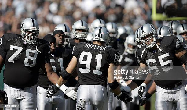 Oakland linebacker Tyler Brayton is welcomed on the field as the Oakland Raiders defeated the Buffalo Bills by a score of 38 to 17 at McAfee Coliseum...