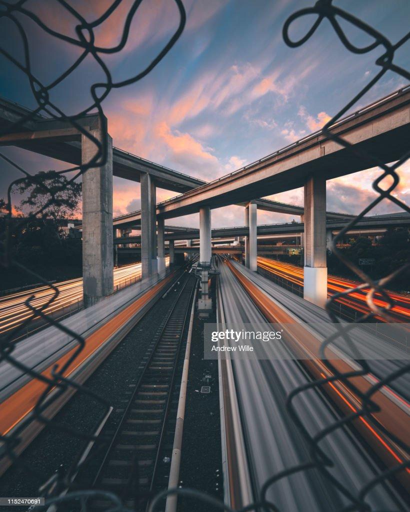 Oakland overpass sunset train light trails : Stock Photo