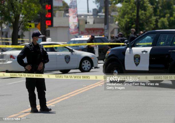 Oakland police investigate a homicide on 35th Avenue near Suter Street in Oakland, Calif., on Wednesday, May 26, 2021. A man believed to be in his...