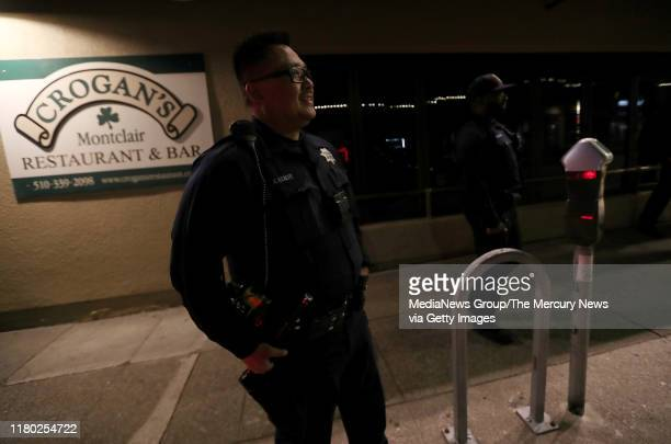 Oakland police officer Ken Kenery monitors an intersection along Mountain Boulevard just before the power went out in the Montclair District of...