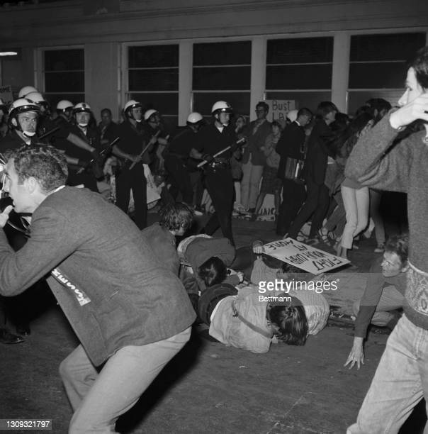 Oakland police, swinging clubs and firing cannisters of eye-stinging liquid, march into a crowd of 2,000 antiwar demonstrators outside the Norther...